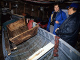 Bill Brett and Mark Ferguson in Bill Brett's store with his boat, Joe Batt's Arm