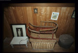 Sled on a basket with pictures, a small table and a hat box in the Brett House, Joe Batt's Arm