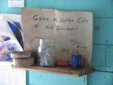 Sign in Peter Emberley's shed, Little Fogo Island