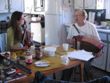 Melvin Combden and Evelyn Osborne sitting at Melvin's kitchen table: accordion playing with Melvin...