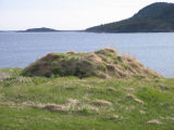 Root cellar in the foreground with the harbour mouth in the distance, Seldom-Come-By