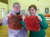 Two pillow top participants show off their finished pillow tops.