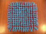 A pillow top woven by Nicole Penney