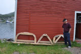 Sturge, S. Stewart Sturge with boat moulds outside his stage, Salvage