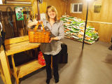 Downey, Junior.  Meghan Felt poses with lunch basket belonging to Grand Falls - Windsor Mill...
