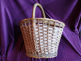 Large woven basket with wrapped handle, St. John's.