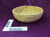 Small coiled grass bowl with braided handle, Rigolet