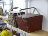 Two mill lunch baskets on a shelf, Corner Brook