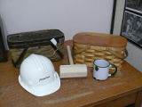 A hard hat, maul, mug and two mill baskets, Grand Falls-Windsor