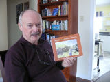 Don Gale, author of Francie and the Basket Women,holding a copy of the book, Stephenville