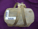 Mill lunch basket with handles tied, Corner Brook