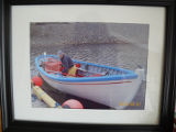 Picture in Calvin Toope's home, make and breka powered wooden boat, Manuels