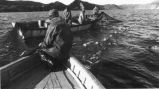 Photograph of a two boat and the crew pulling in a cod trap on Bonavista Bay