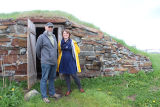 Johnson, Don; Barrett, Terra. Portrait of Johnson and Barrett outside a root cellar in Elliston,...