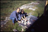 Delf Hohmann and Brigitte Beyer cooking, Hopedale, Labrador