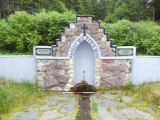Father Duffy's well front view with scale
