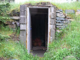 Boland root cellar, exterior, Logy Bay-Middle Cove-Outer Cove.