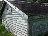 Bryant's Cove 3 root cellar, exterior back.  Bryant's Cove, Newfoundland.
