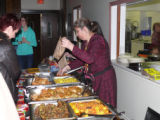 Kurayeva, Maral. Photo of Kurayeva selling food at her table at Newfiki: Cultural Concert Night