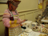 "Hlinik, Alena. Photo of Alena Hlinik selling traditional ""Soviet"" cookies at Newfiki: Cultural Concert"