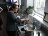 Lesiv, Mariya. Photo of Mariya Lesiv teaching how to boil the pierogies at the Pierogi Workshop.