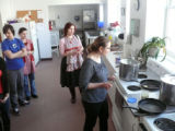 Lesiv, Mariya. Photo of Mariya Lesiv teaching how to fry onions for the pierogies at the Pierogi...