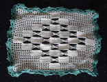 Tucker, Irene.  A green and white square doily made by Irene Tucker, Quirpon.