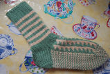 Young, Joyce.  A pair of green and brown zig-zag socks made by Joyce Young, Quirpon.