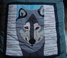 Young, Joyce.  A wolf themed quilted pillow cover made by Joyce Young, Quirpon.