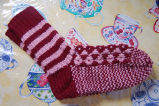 Young, Joyce.  Red and pink traditional diamond pattern socks made by Joyce Young, Quirpon.