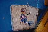 Young, Joyce.  A cross-stich wall hanging made by Joyce Young, Quirpon.