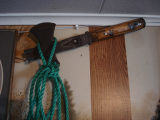Carroll, Gertrude.  A wooden axe that belonged to Gert Carroll's father in law, Conche,...