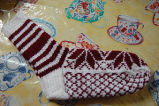 Young, Joyce.  A pair of white and red traditional pattern snowflake socks made by Joyce Young,...