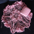Tucker, Irene.  A pink work-in-progress doily by Irene Tucker, Quirpon.