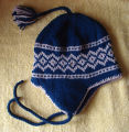 Patey, Karen H.  A blue diamond pattern winter hat made by Karen Patey, Quripon.