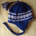 Patey, Karen H.  A blue and beige diamond pattern winter hat made by Karen Patey, Quirpon.