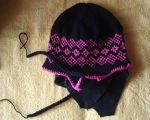 Patey, Karen H.  A work-in-progress black and pink winter hat made by Karen Patey, Quirpon.