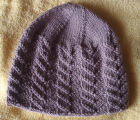 Patey, Karen H.  A brown winter hat with cables knitted by Karen Patey, Quirpon.