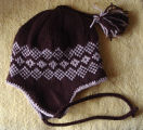 Patey, Karen H.  A brown and beige diamond pattern winter hat made by Karen Patey, Quirpon.