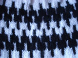Patey, Karen H.  Close-up of a white and black winter hat made by Karen Patey, Quirpon.