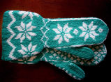 Hunt, Gertrude.  Traditional snowflake pattern mittens with the cuff made by Gert Hunt, Conche,...