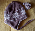 Patey, Karen H.  A brown and white traditional snowflake pattern winter hat made by Karen Patey,...