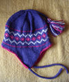Patey, Karen H.  A purple and pink diamond pattern winter hat made by Karen Patey, Quirpon.