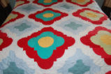 Wilcox, Naomi.  A yellow and red patchwork quilt made by Naomi Wilcox, Roddickton.