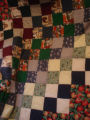 Norman, Doris.  A country themed patchwork quilt made by Doris Norman, Roddickton.