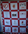 Reid, Marie and Oliver.  A wedding quilt with picket fence edging made by Marie Reid, Roddickton.