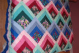 Wilcox, Naomi.  A colorful patchwork quilt made by Naomi Wilcox, Roddickton.