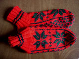 Carroll, Gertrude.  Traditional double-knit snowflake pattern slippers made by Gert Carroll,...