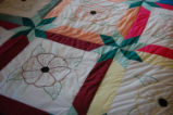 Wilcox, Naomi.  A colorful embroidered flower quilt made by Naomi Wilcox, Roddickton.