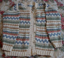 Bromley, Mary. A button-up knitted sweater made by Mary Bromley, Conche, Newfoundland.